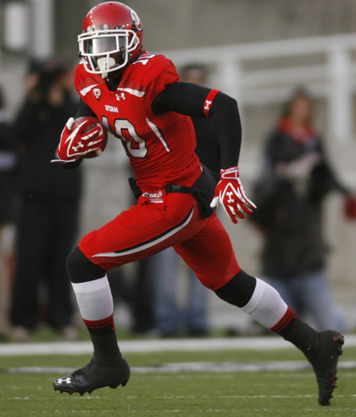 Trent Nelson  |  The Salt Lake Tribune Utah's DeVonte Christopher runs with the ball during the second half, Utah vs. Colorado, college football at Rice-Eccles Stadium in Salt Lake City, Utah, Friday, November 25, 2011