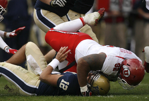Trent Nelson  |  The Salt Lake Tribune Utah's Star Lotulelei tackles Pitt quarterback Tino Sunseri during the first half. Utah vs. Pitt, college football at Heinz Field Stadium in Pittsburgh, Pennsylvania, Saturday, October 15, 2011.