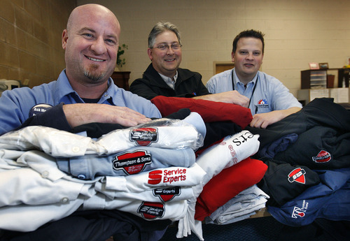 Scott Sommerdorf  |  The Salt Lake Tribune              Service Experts employees (from left to right), Sean Straatsma, Ken Best - area Operations manager, and Kevin Perkins - branch manager pose with a small representation of some of the clothing with outdated logs they will be donating to Good360, Service Experts, which does heating and air conditioning in Canada and the U.S. They changed their logo and have excess uniforms - including hoodies and coats - to get rid of. The perfectly good clothing is being donated to Good360. The Midvale office for Service Experts is amassing the clothing for this region and will ship it off some time next week.Good360,  Friday, December 30, 2011. Corporations and Fortune 500 companies unload their excess items and Good360 helps them get to people in need who can use them.