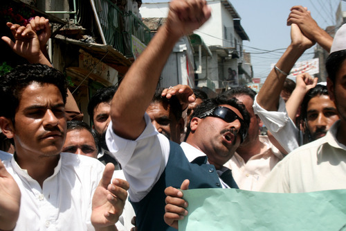 Pakistani students chant anti-U.S. slogans during a rally to condemn the killing of al-Qaida leader Osama bin Laden and American's drone attacks on Pakistani tribal areas where militants are hiding, on  Wednesday, May 18, 2011 in Abbottabad, Pakistan. Osama bin Laden was killed by a U.S. helicopter-borne military force in a fortress-like compound on the outskirts of Abbottabad.(AP Photo/Aqeel Ahmed)