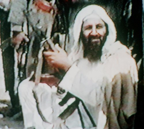 This image made from television shows Osama bin Laden holding an AK47 automatic rifle in an undated recruitment video tape for his organization, viewed by The Associated Press in Kuwait City on June 19, 2001. As bizarre as it might be to know bin Laden spent his last months surrounded by children, any thought of domestic tranquility is probably a stretch. There is no dispute that bin Laden spent time in his lair dreaming up ways to kill Americans in great numbers again, for the terrorist believed that only mass casualties could move U.S. policy.  (AP Photo/File)