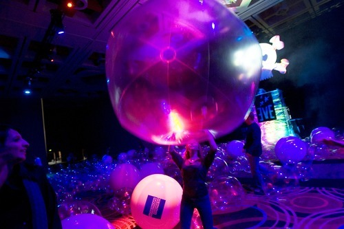 Kim Raff  |  The Salt Lake Tribune Sadie Douglas tries to pick up a giant inflated ball in the Ballroom during the first night of EVE at the Salt Palace in Salt Lake City on Thursday.