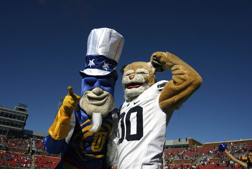 Rick Egan  | The Salt Lake Tribune   Captain Cain and Cosmo the Cougar pose for photos before football action BYU, vs. Tulsa, in the Armed Forces Bowl, in Dallas, Texas, Friday, December 30, 2011Friday, December 30, 2011.