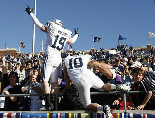 Rick Egan  | The Salt Lake Tribune   Brigham Young Cougars wide receiver Matt Marshall (19)and running back JJ Di Luigi (10) climb into the stands to celebrate the 24-21 win over Tulsa in the Armed Forces Bowl, in Dallas, Texas, Friday, December 30, 2011