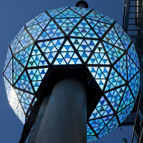 The Times Square New Year's Eve Ball rises to the top of it's 135 foot spire, Friday, Dec. 30, 2011, in New York. A crowd cheered as the ball dropped in a dress rehearsal around noon Friday as preparations continued for New York's big welcome party for 2012. (AP Photo/John Minchillo)