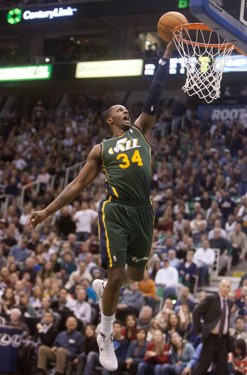 Jeremy Harmon  |  The Salt Lake Tribune  Utah's C.J. Miles (34) scores on a fast break as the Jazz face the 76ers at EnergySolutions Arena on Friday, December 30, 2011.