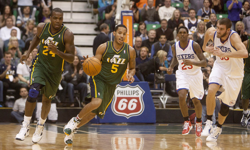 Jeremy Harmon  |  The Salt Lake Tribune  Utah's Devin Harris runs the ball downcourt during a scoring run that saw the Jazz overtake the 76ers as the hirst half drew to a close at EnergySolutions Arena on Friday, December 30, 2011.