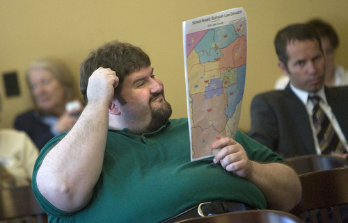 Al Hartmann  |  Tribune File Photo Chad Smith, of West Valley City, looks at maps at the Legislature's Redistricting Committee came up with during the many public hearings on drawing new voting boundaries in the state.