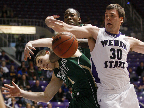 Weber State forward Darin Mahoney (30) fights for a rebound against Sacramento State guard Jackson Carbajal (1) and forward John Dickson during an NCAA college basketball game Saturday, Dec. 31, 2011, in Ogden, Utah. (AP Photo/Standard-Examiner, Nicholas Draney) TV OUT  MANDATORY CREDIT