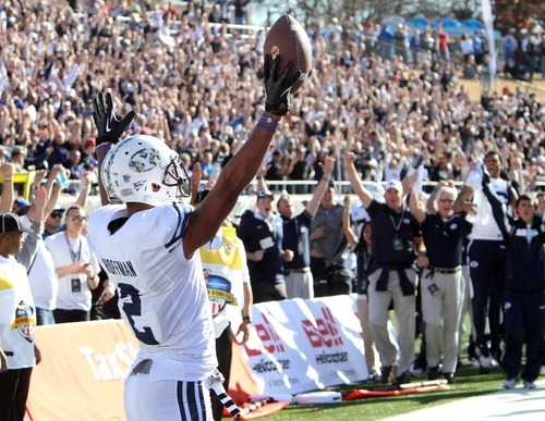 Rick Egan  | The Salt Lake Tribune   Wide receiver Cody Hoffman (2) celebrates the winning touchdown in the 24-21 win over Tulsa in the Armed Forces Bowl, in Dallas, Texas, Friday, December 30, 2011
