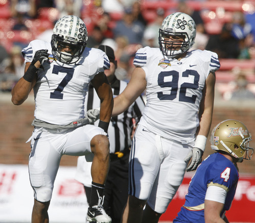 Rick Egan  | The Salt Lake Tribune   Cougars defensive back, Preston Hadley (7) and Brigham Young Cougars defensive end Graham Rowley (92) celebrate the sack of Tulsa Golden Hurricane quarterback G.J. Kinne (4) in football action, BYU vs. Tulsa, in the Armed Forces Bowl, in Dallas, Texas, Friday, December 30, 2011