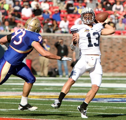 Rick Egan  | The Salt Lake Tribune   Tulsa Golden Hurricane defensive end Cory Dorris (93) puts the pressure on Brigham Young Cougar quarterback Riley Nelson (13) in first half action in the Armed Forces Bowl, BYU vs. Tulsa, in Dallas, Texas, Friday, December 30, 2011
