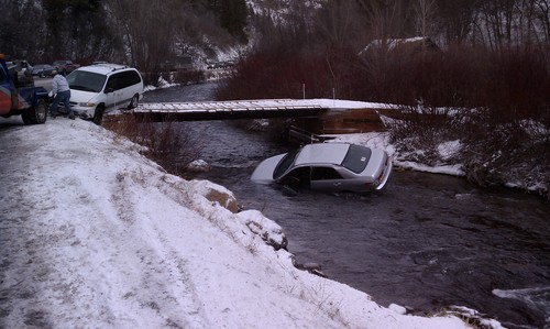 Courtesy KUTV Three children were rescued from submerged car in the Logan River Saturday. Several state troopers said drivers commonly slide off the highway and into the Logan River about two miles east of Rick Springs along U.S. 89 near Logan Cave. As many as 30 vehicles have lost control at the same spot this winter.