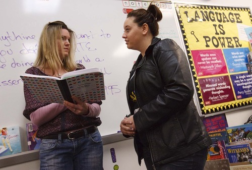 Leah Hogsten | The Salt Lake Tribune   Two Rivers High School student Sarah Nona gets advice from school guest speaker and novelist Wendy Toliver (left) about writing in Nona's writing class with teacher Cassie Cox.  Cassie Cox, a teacher who started a program to bring authors to her class once a week and create a literary magazine for her students using UEA Children at Risk Foundation grant money to support her students at Two River High School, Tuesday, December 13, 2011 .