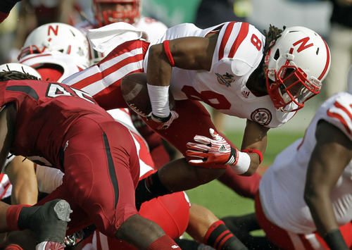 Nebraska running back Ameer Abdullah (8) dives over the South Carolina goal for a 1-yard touchdown during the first half of the Capital One Bowl NCAA college football game, Monday, Jan. 2, 2012, in Orlando, Fla. (AP Photo/John Raoux)