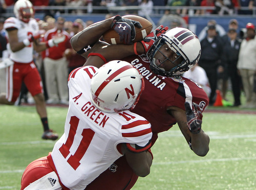 Nebraska cornerback Andrew Green (11) breaks up a pass intended for South Carolina wide receiver DeAngelo Smith during the second half of the Capital One Bowl NCAA college football game, Monday, Jan. 2, 2012, in Orlando, Fla. South Carolina won 30-13. (AP Photo/John Raoux)