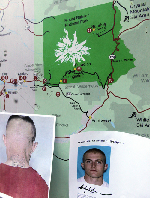 Photos provided by the Pierce County Sheriff's Dept. of Benjamin Colton Barnes, are taped to a map of the Mount Rainier area, at Mount Rainier National Park, Sunday, Jan. 1, 2012 in Washington State. A Mount Rainier National Park ranger was fatally shot following a New Year's Day traffic stop, and the 368-square-mile park in Washington state was closed as dozens of officers searched for the armed gunman over snowy and rugged terrain. Officials said Barnes is a person of interest in the fatal shooting. (AP Photo/Ted S. Warren)