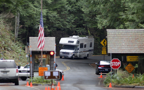 A Tacoma Police tactical operations van leaves Mount Rainier National Park, Wash. on Monday, Jan. 2, 2012, the day after Park Ranger Margaret Anderson was killed by a gunman inside the park. The park remained closed Monday as officials searched for the gunman, who remained at-large after he fled on foot. (AP Photo/Ted S. Warren)