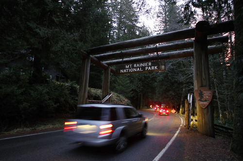 Law-enforcement vehicles enter Mount Rainier National Park, Wash. at sunrise, Monday, Jan. 2, 2012, the day after Park Ranger Margaret Anderson was killed by a gunman inside the park. The park remained closed Monday as officials searched for the gunman, who remained at-large after he fled on foot. (AP Photo/Ted S. Warren)