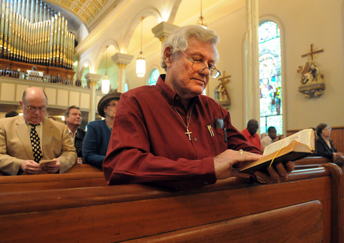 Walter Warren McGehee of Montgomery, Ala., participates in Mass Sunday, Nov. 27, 2011 at St. Peter's Catholic Church in Montgomery, Ala. Catholics nationwide began using a new translation of the Roman Missal on Nov. 27, 2011. (AP Photo, David Bundy)