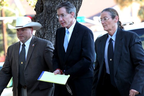 Warren Jeffs is taken into the side entrance of the Tom Green County Courthouse in San Angelo, Texas, on Monday, Aug. 8, 2011. Jurors convicted Jeffs last week of sexually assaulting two girls, ages 12 and 15, whom he had taken as brides. He faces up to life in prison. Jeffs has led the Fundamentalist Church of Jesus Christ of Latter-Day Saints since 2002. (AP Photo/ San Angelo Standard-Times, Patrick Dove)
