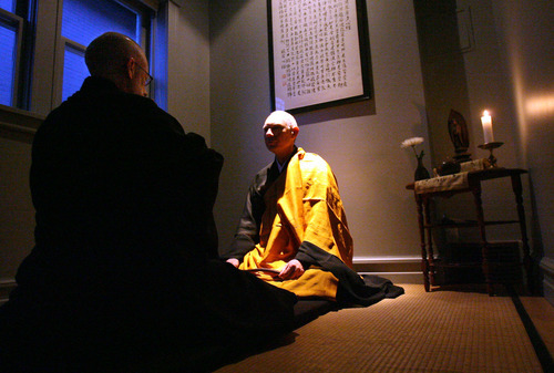 In this 2005 Tribune file photo, Genpo Roshi Dennis Merzel, Zen Master, interviews Michael Zimmerman to test his conceptual mind and transcendental understanding to help him go beyond the dualistic mind.