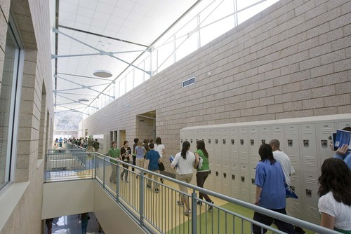 Paul Fraughton | The Salt Lake Tribune  Students walk down the bright, naturally lit hallways of the new Hillside Middle School, one of several schools in Salt Lake City School District that were rebuilt to address seismic safety concerns throughout the district. Hillside earned national certification as a green building.
