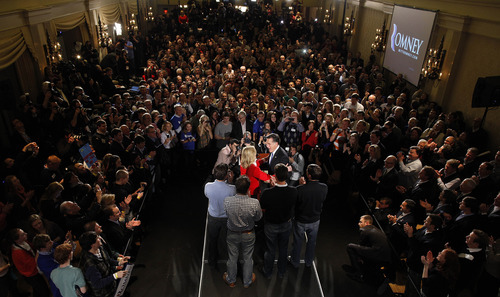 Republican presidential candidate, former Massachusetts Gov. Mitt Romney hugs his wife Ann during a Romney for President Iowa Caucus night rally in Des Moines, Iowa, Jan. 3, 2012. (AP Photo/Charlie Neibergall)