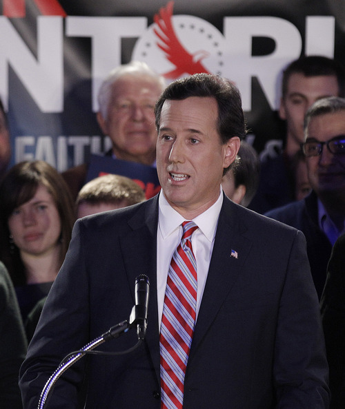Republican presidential candidate, former Pennsylvania Sen. Rick Santorum addresses supporters at his Iowa caucus victory party Tuesday, Jan. 3, 2012, in Johnston, Iowa. (AP Photo/Charlie Riedel)