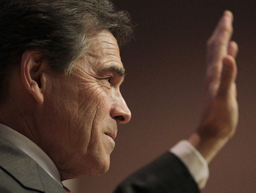 Republican presidential candidate, Texas Gov. Rick Perry speaks during a campaign stop in Des Moines, Iowa, Tuesday, Jan. 3, 2012. (AP Photo/Chris Carlson)
