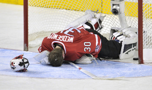 Canada goalie Scott†Wedgewood lies in front of his net following a goal by Russia's Yevgeni†Kuznetsov during the second period of a semifinal in the world junior hockey championships in Calgary, Alberta, on Tuesday, Jan. 3, 2012. (AP Photo/The Canadian Press, Nathan Denette)