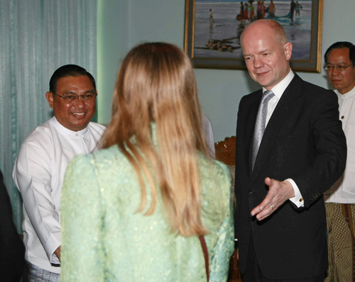 Visiting British Foreign Secretary William Hague, right,  introduces a staff to his Myanmar couinterpart Wunna Maung Lwin, left, during their meeting at Foreign Ministry Thursday, Jan. 5, 2012 in Naypyitaw, Myanmar. Hague began a two-day visit to Myanmar Thursday. (AP Photo/Apichart Weerawong)