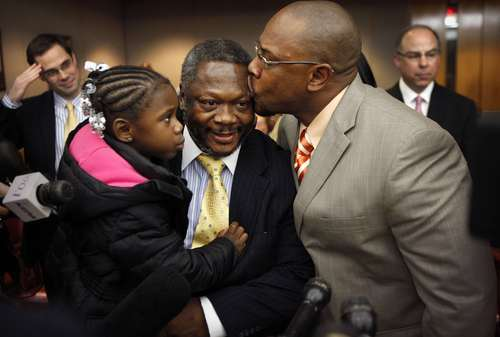 Ricky Wyatt, 56, of Dallas, holds his four year-old granddaughter Caribbean Hill while he receives a kiss from his nephew Robert Smith of DeSoto after he was set free at the Frank Crowley Criminal Courts building, Wednesday, Jan. 4, 2012 in Dallas. A Texas judge has vacated the conviction of Ricky Wyatt a 56-year-old man after he spent 31 years in prison for aggravated sexual assault. (AP Photo/The Dallas Morning News, Tom Fox)  MANDATORY CREDIT; MAGS OUT; TV OUT; INTERNET OUT; AP MEMBERS ONLY