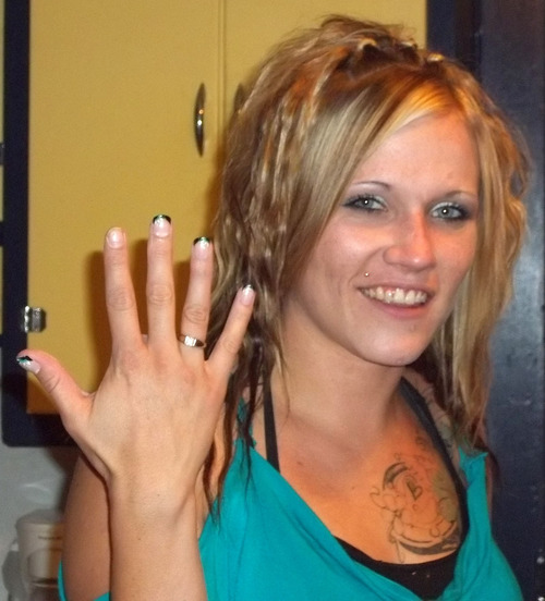 Recent photo of Angela Hill showing off her engagement ring from Ben  Jensen.   Photo courtesy of Mike and Denise Atwood.