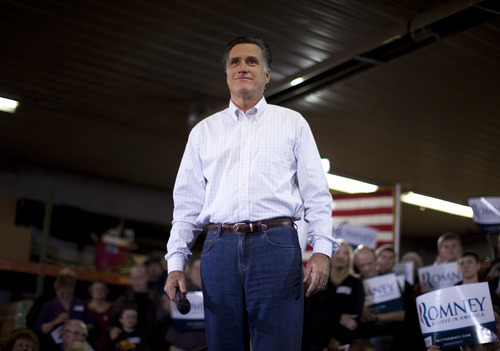 Republican presidential candidate former Massachusetts Gov. Mitt Romney makes remarks during a campaign stop on Monday, Jan. 2, 2012, in Marion, Iowa.  (AP Photo/Evan Vucci)