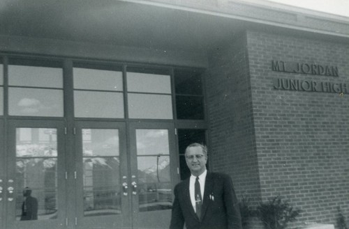 Courtesy   Mount Jordan Memory Project Mount Jordan's first-ever principal Glendon Reed Sanderson stands in front of the school.