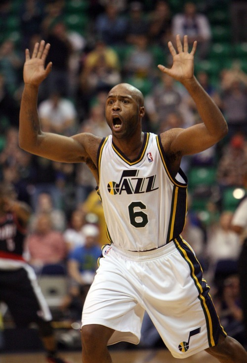 Steve Griffin  |  The Salt Lake Tribune  Utah's Jamaal Tinsley holds his hands in the air claiming he didn't tip the ball out of bounds during second half action of the Utah Jazz versus Portland Trail Blazers game at EnergySolutions Arena in Salt Lake City, Utah Wednesday, December 21, 2011. The refs agreed with him reversing their original call after watching a video replay.