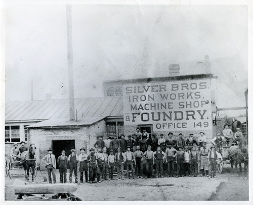 Tribune file photo  A group of men is seen at the Silver Bros. Iron Works Machine Shop and Foundry in this undated photo.