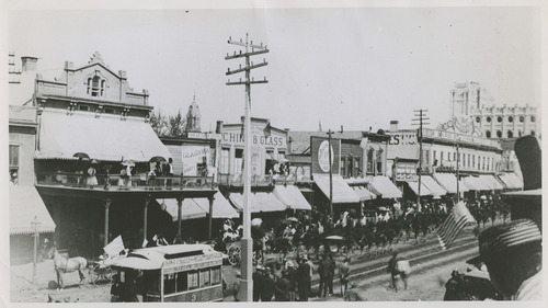 Tribune file photo  A view of Main Street is seen in the 1880s. In the background, the unfinished spires of the Salt lake Temple start to take form.