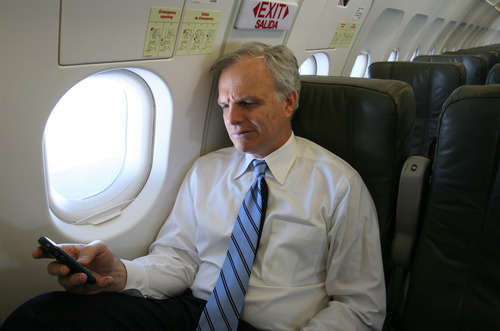Mark Lennihan  |  AP file photo David Neeleman, founder and chairman of JetBlue, checks his BlackBerry during a media preview flight aboard