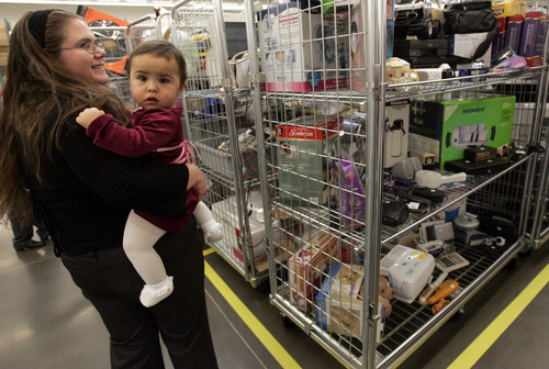 Tribune file photo Heather Garcia of Layton and her 9-month-old daughter, Mezmeriah Garcia, walk through the sorting center at the LDS Church's welfare complex in Layton at 930 W. Hillfield Road in 2008.