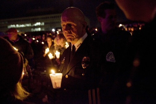 Kim Raff I The Salt Lake Tribune Ogden Police Chief Wayne Tarwater talks with people during a candle light vigil for Agent Jared Francom, who was killed, and the five other officers who were wounded in a gun battle with a suspect the night before, at the Ogden Amphitheater in Ogden, Utah on January 5, 2012.