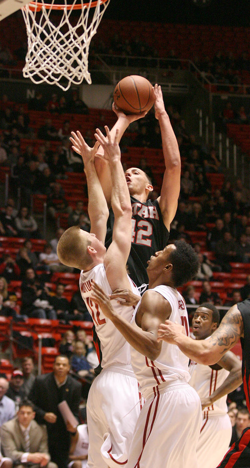 Paul Fraughton | The Salt Lake Tribune. Pressured by Washington State defenders,  Utah's Jason Washburn gets off the shot.Utah played Washington State in the Huntsman Center.  Thursday, January 5, 2012