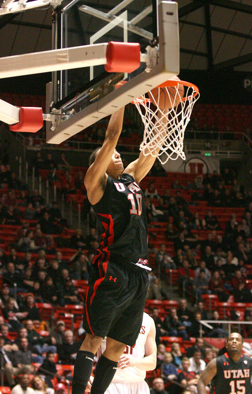 Paul Fraughton | The Salt Lake Tribune. Utah's Dijon Farr slams the ball down on an Alley Oop pass.Utah played Washington State in the Huntsman Center.  Thursday, January 5, 2012