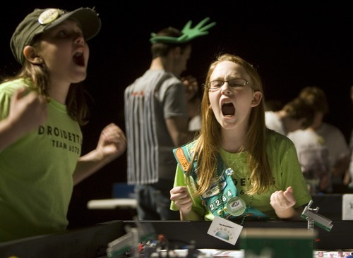 Kim Raff I The Salt Lake Tribune Zoe Reid a member of the Droidettes, a team organized by the Girl Scouts of Utah, celebrates scoring points during the Utah FIRST LEGO League competitionat Murray High School on Saturday.