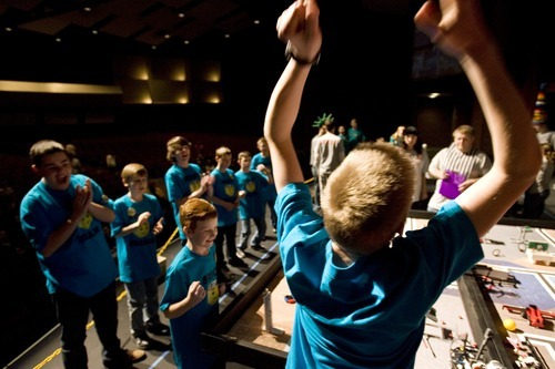 Kim Raff I The Salt Lake Tribune Brick Brains, a team organized by the Utah Christian Homeschool Association, celebrates a score during the Utah FIRST LEGO League competition at Murray High School on Saturday.