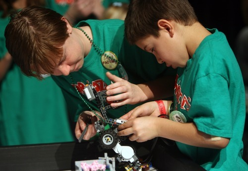 Kim Raff I The Salt Lake Tribune (left) Caleb Jackson and Michael Johnson, members of Droidzilla, a team based out of the Boys & Girls Club of South Valley, work on their robot during the Utah FIRST LEGO League competition at Murray High School on Saturday.
