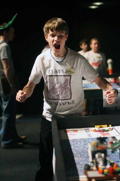 Kim Raff I The Salt Lake Tribune Connor Lewis, a member of the Purple Banana Fish team, celebrates a score during the Utah FIRST LEGO League competition hosted at Murray High School on Saturday.