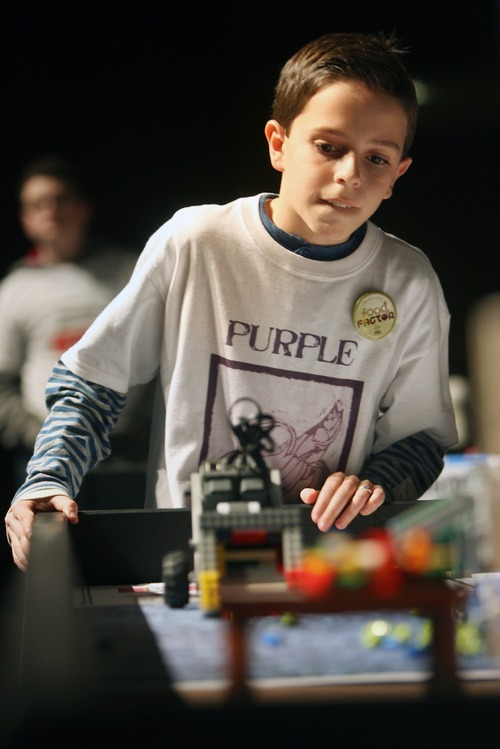 Kim Raff I The Salt Lake Tribune Cameron Jeppson, a member of the Purple Banana Fish team, competes with his team during the Utah FIRST LEGO League competition at Murray High School on Saturday.