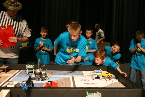 Kim Raff I The Salt Lake Tribune Members of Brick Brains, a team organized by the Utah Christian Homeschool Association, watch their robot during the Utah FIRST LEGO League competition at Murray High School on Saturday.